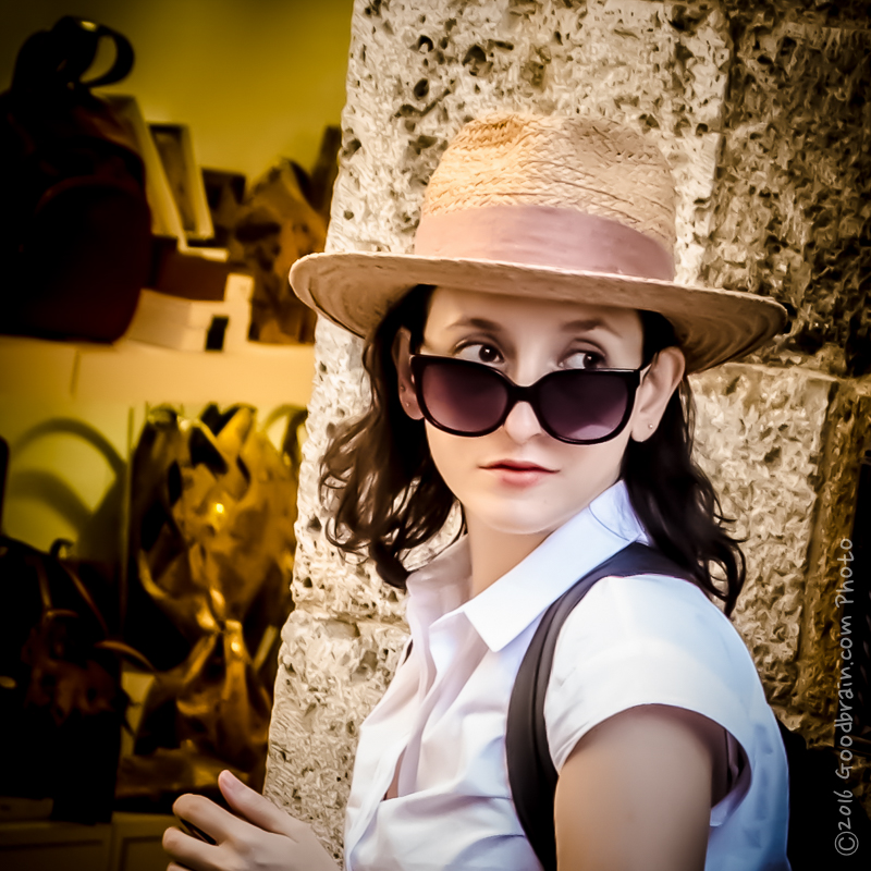 This is an image of a lovely young lady in a hat with sunglasses...captured by Crystal Nadeau in Italy in 2016.